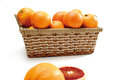 Oranges in basket isolated on white background Royalty Free Stock Image