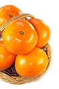 Oranges in a basket on isolated white background Royalty Free Stock Photo