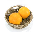 Oranges in the basket on white background Stock Images