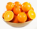 Oranges in a bowl against a white background Stock Photography
