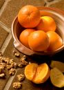 Oranges in a bowl on Spanish tile Stock Photography