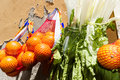 Oranges and celery fruit vegetables hanging outside on a shop wall Stock Images
