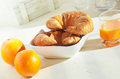 Oranges and croissants for breakfast Royalty Free Stock Photography