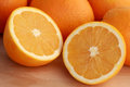 Oranges fresh cut into halves Stock Photography