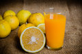 Oranges fresh with a glass of orange juice Royalty Free Stock Photos