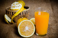 Oranges fresh with a glass of orange juice Royalty Free Stock Images