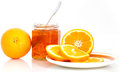 Oranges and marmalade orange slices in a jar isolated on white background Royalty Free Stock Photo