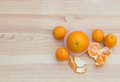 Oranges in paper small baskets on wooden texture with tangerines orange light Stock Photo