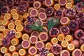 Oranges and pomegranates are sliced for juice Royalty Free Stock Photo