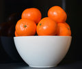 Oranges in white bowl with a black background Royalty Free Stock Photo