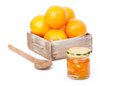 Oranges in wooden box with orange jam in the  jar Royalty Free Stock Image