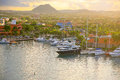 Oranjestad aruba harbor in early morning the warm glow of the sun shining over the city and of Royalty Free Stock Photos