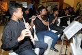 Orchestra vocational school students are being performed orchestral music in a hotel in the city of solo central java indonesia Stock Photos