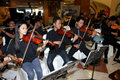 Orchestra vocational school students are being performed orchestral music in a hotel in the city of solo central java indonesia Stock Image