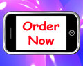 Order now on phone shows buying online showing in web stores Stock Photos
