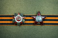 Order of the patriotic war and of the red star on st georges ribbon on a bronze background Stock Photography