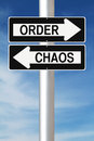 Order versus chaos modified one way street signs indicating and Stock Photos