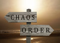 Order vs chaos sign double road opposite directions or Royalty Free Stock Photo