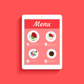 Ordering food in restaurant via mobile app displayed on tablet pc Royalty Free Stock Image