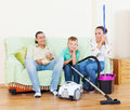 Ordinary family of three finished housework portrait Royalty Free Stock Photo