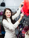 Ordinary girl choosing bra at clothing store Stock Images