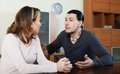 Ordinary man with wife talking men in home interior Royalty Free Stock Images