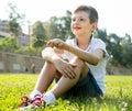 Boy sitting grass Royalty Free Stock Photo