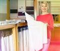 Ordinary woman choosing interesting fabric