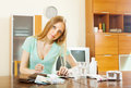 Ordinary woman counting the cost of medications for treatment at home Stock Photography