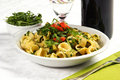 Orecchiette, with rucola salad and tomatoes Stock Image