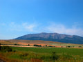 Oregon farm field wallowa mountains provide a beautiful background for land Stock Photos