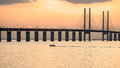Oresund bridge at dusk viewed from the swedish side the which connects sweden and denmark is meters long and continues into Stock Photos