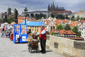 Organ grinder on the charles bridge in prague Stock Images