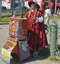 Organ grinder with parrot st petersburg russia july gringer playing on barrel on street of st petersburg Stock Images
