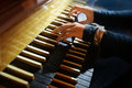 Organ player s hand s playing organ two keyboards Stock Images