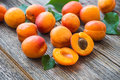 Organic apricots with leaves Royalty Free Stock Photo