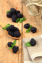 Organic berry sweet blackberry on wooden table Royalty Free Stock Photography