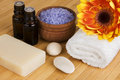 Organic body care products natural set soap lavender sea salt aroma oils arranged with flower and pebbles on bamboo Stock Images