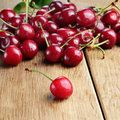 Organic cherries on the wooden table closeup Stock Photos