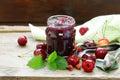 Organic cherry jam with fresh berries