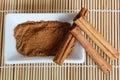 Organic cinnamon powder and sticks Royalty Free Stock Photo