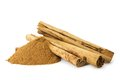 Organic cinnamon sticks and cinnamon spice powder side view on white background Stock Photography