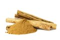 Organic cinnamon sticks and cinnamon spice powder side view on white background Royalty Free Stock Image