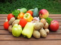 Organic food background vegetables on the old wooden table Stock Photos