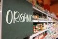 Organic food signage on modern supermarket grocery aisle Royalty Free Stock Photo