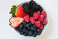 Organic fresh mixed fruit in a bowl on the table. Royalty Free Stock Photo
