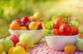 Organic fruits and vegetables fresh on a table in a bowls Royalty Free Stock Photos