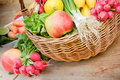 Organic fruits and vegetables fresh in wicker basket Royalty Free Stock Images
