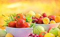 Organic fruits and vegetables on a table fresh in bowls closeup Stock Image