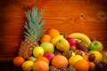 Organic fruits on wooden bacground Royalty Free Stock Photos